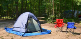 Campsite with chairs and tent poster