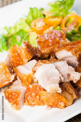 fried pork belly and oriental salad on a side