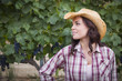 Young Adult Female Portrait Wearing Cowboy Hat in Vineyard