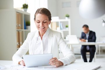 Businesswoman with touchpad