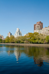Central Park Lake and buildings in New York City, USA