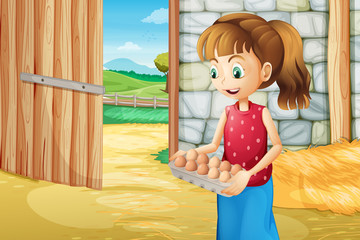 A girl holding an eggtray inside the barnhouse