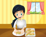 A happy woman preparing sandwiches