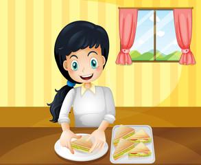 A happy woman preparing sandwiches