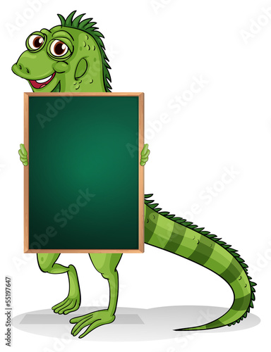A greenboard with an iguana at the back