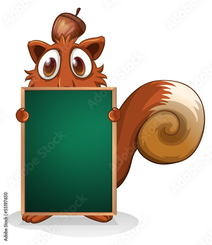 A squirrel hiding at the back of an empty blackboard