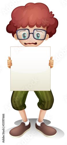 A sad boy holding an empty signage