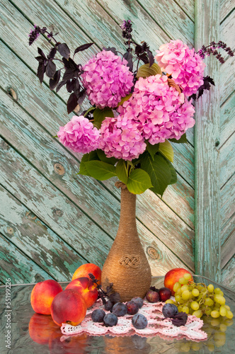 still life with pink hydrangea and violet basil