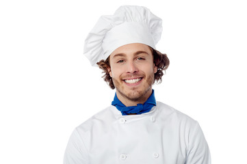 Young male chef wearing toque