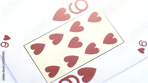 Nine of Hearts playing card rotates on white background