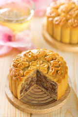 Assorted fruits nuts mooncakes with tea