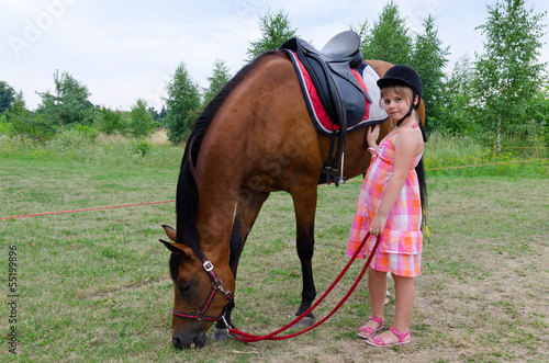 Cute girl with arabian horse