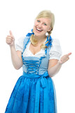 girl in oktoberfest dirndl shows thumbs up
