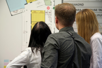 Students looking at university map