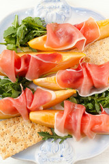 Appetizer with melaon and prosciutto