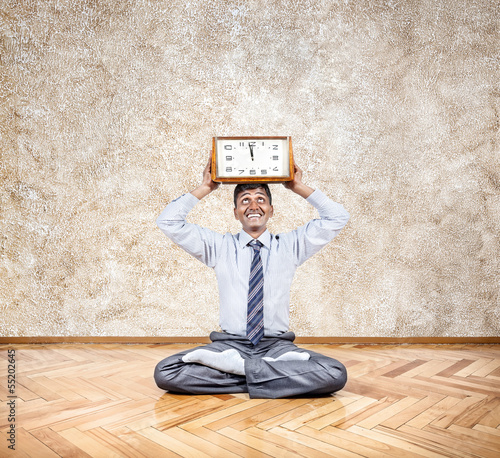 Business yoga with clock