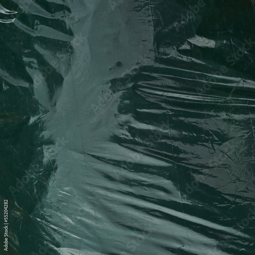 Green plastic garbage bag
