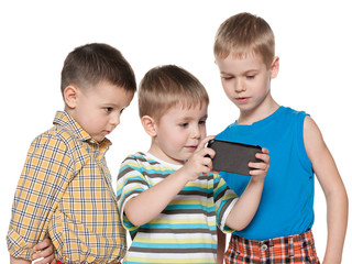 Young children plaing with a new gadget