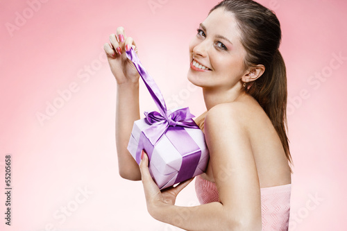 Young beautiful girl with a gift box ribbon