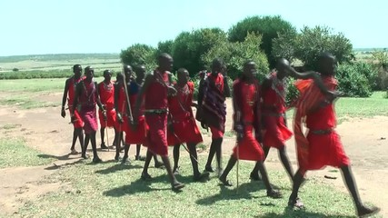Masai warrior dance and sing in their Manyatta
