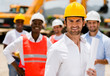Architect with a group of construction workers