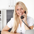 Female office assistant has a call at the office