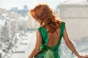 Red hair woman. Rear view of beautiful young red hair woman look