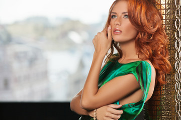 Red hair beauty Beautiful young red hair woman holding her hand