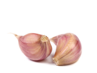 Red garlic cloves isolated on white