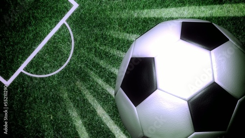 Soccer ball rotating with light rays on a soccer field