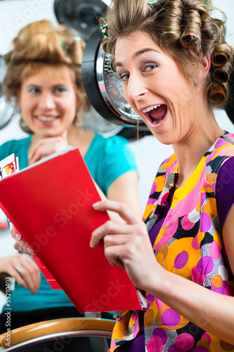 Women at the hairdresser with hair dryer