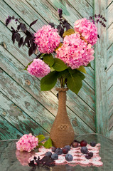 pink hydrangea and violet basil bouquet in a vintage vase