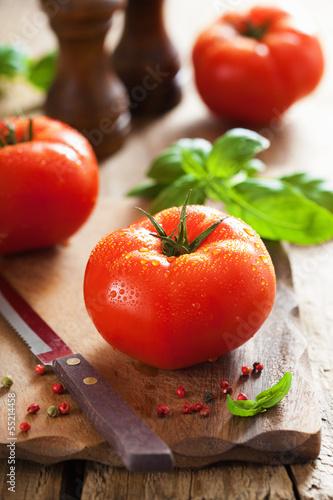 fresh beef tomatoes on cutting board