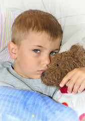 Ill boy with teddy bear