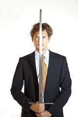 Silent businessman holding sword