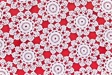 Handmade white lace on red s background