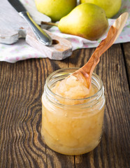 Homemade pear jam on  wooden board