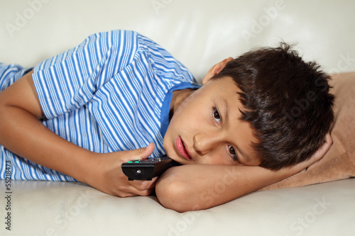 Young boy watching TV