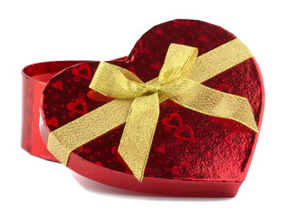 Heart shaped red gift box on black background
