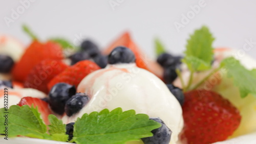 ice cream with fresh berries and mint closeup