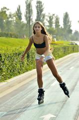 Girl roller-skating in the street