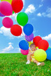 Toddler girl sitting a bunch of balloons