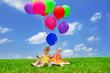 Toddler friends under balloons