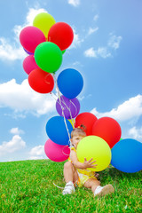 Toddler girl playing with balloons