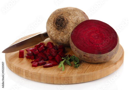 Sliced beetroot on board isolated on white