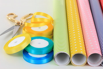 Color papers for wrapping gifts isolated on white