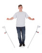 Young Handsome Man Leaving Crutches