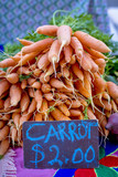 Carrots and a sign with the price they cost