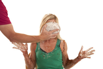 Woman with a pie in her face