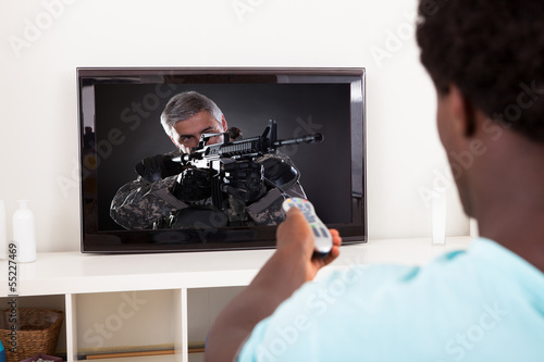 African Young Man Watching Television